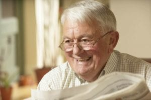 Smiling elderly gentleman showing off his dental implants at Dentist Wolverhampton