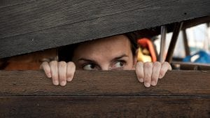 Women hiding as she hate going to the dentist