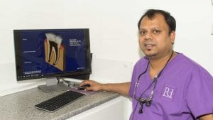 Wolverhampton Dentist Dr Kristlee Fernandes with an picture of root canal treatment